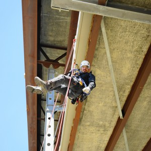 repelling construction worker